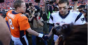 A handshake showing the respect that two of the greatest quarterbacks in the history of the NFL had for each other.