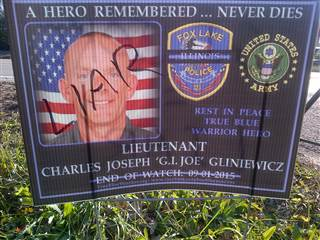 "A memorial poster of Lt. Gliniewicz now defaced with the word ""LIAR."""