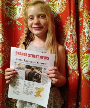 Journalist Hilde Kate Lysiak shows off her newspaper, the Orange Street News.