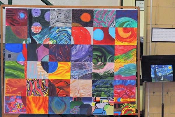 The entire art club worked together to create one square each to complete their one-of-a-kind version of Starry Night.