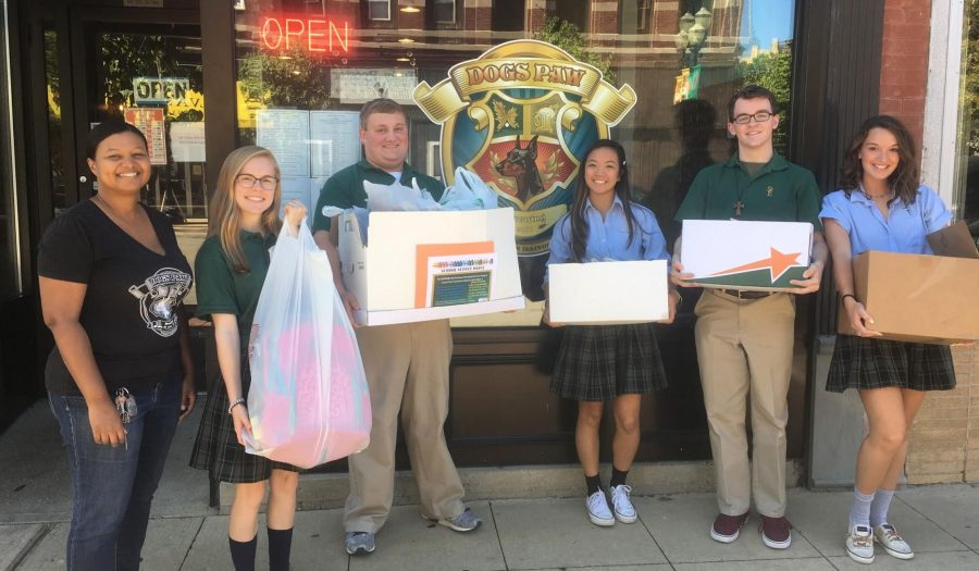 Students picking up donated supplies from Charlotte and customers at Dog's Paw Brewing in downtown Elgin.