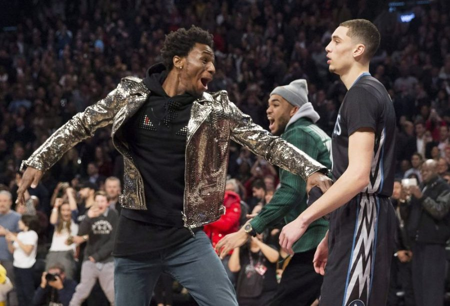Andrew Wiggins (shiny jacket) and Karl-Anthony Towns (green jacket) go crazy during Zach LaVine's second consecutive Dunk Contest win.