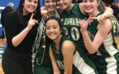 Manager Kelly Dalton celebrates the Lady Wave's sectional victory with seniors Brittany Mauritzen and Taylor Schueler and juniors Maddison Knott and Yssa Sto. Domingo.