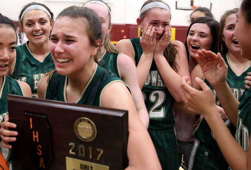 Maddie Spagnola (holding the Super Sectional plaque) emotionally celebrates making it to State with her teammates.