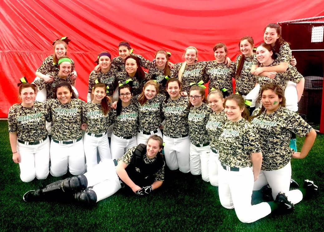 JV and varsity softball players pose after a game in Peoria.