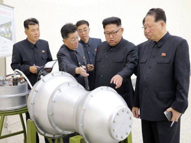 Kim Jong Un inspects what is believed to be a hydrogen bomb.