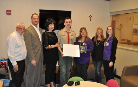 Pictured (from left): Hoffman Estates Mayor McLeod, father Vito, mother Maria, Luca Corso, Katie Hammerber, Linda DeLarco, and Mary Kate