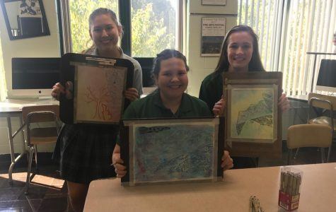 (From left) Lauren Biggins, Katie Sohoov, and Madison Knott. The students created these non-objective designs using ink on watercolor in advanced Art (Art III).
