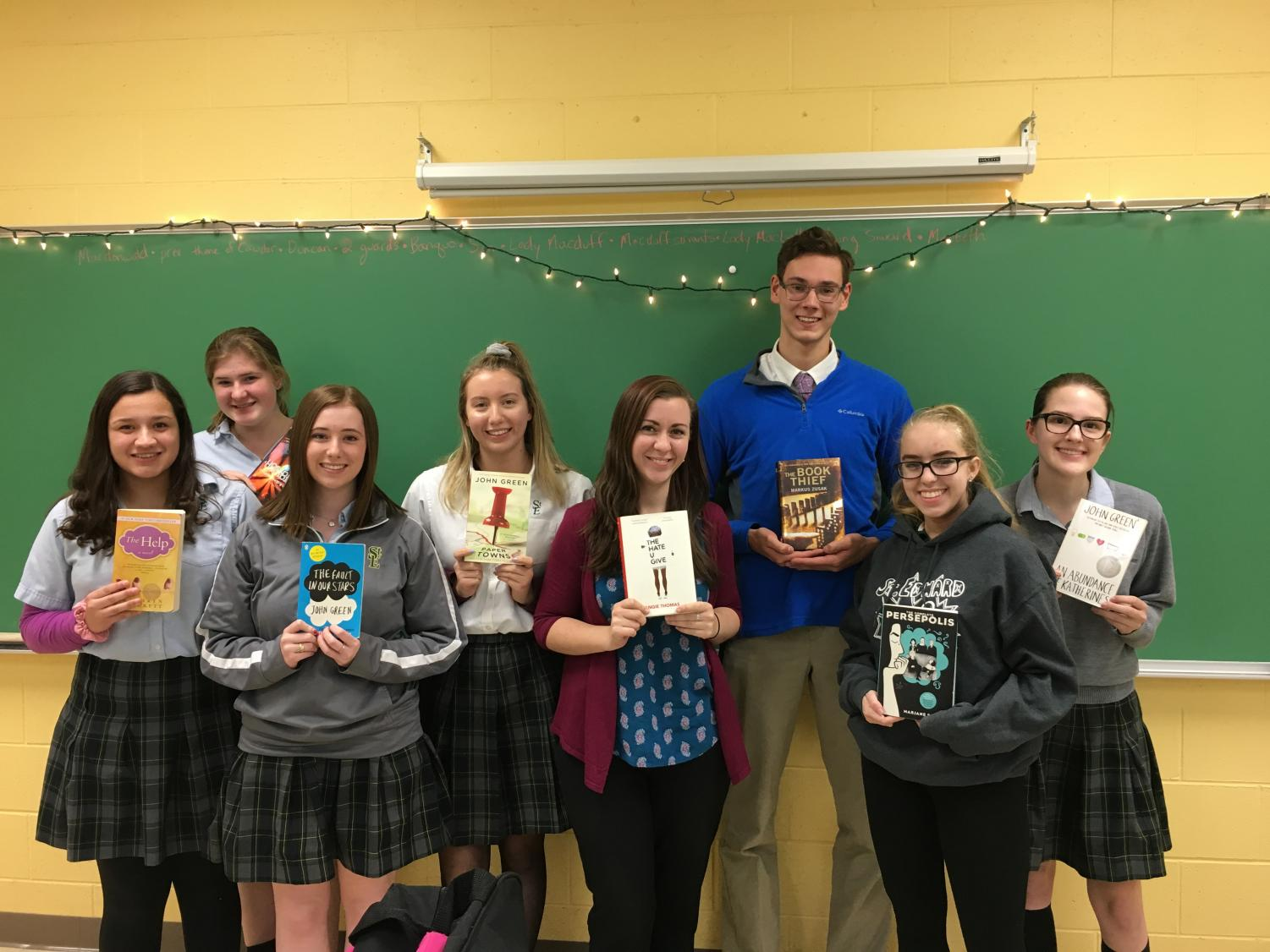 Members of Book Club, posing with their favorite books.