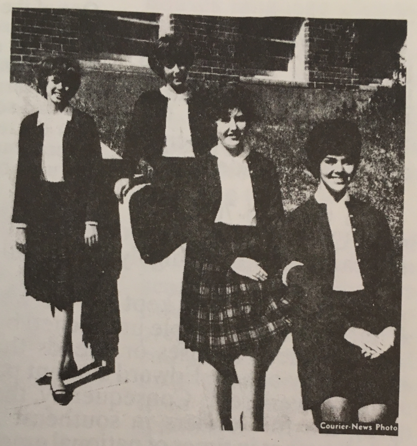 plaid skirts with white lapel school shirts and dark colored cardigans with black-soled shoes