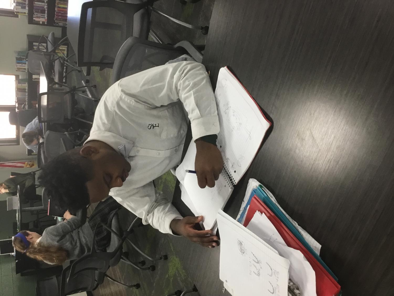St. Edwards student James Brisco working on homework