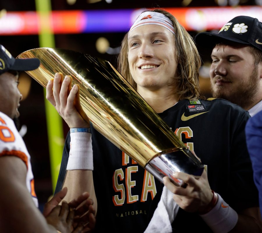 Clemson%27s+Trevor+Lawrence+holding+the+National+Champioship+trophy+after+defeating+Alabama+44-16.