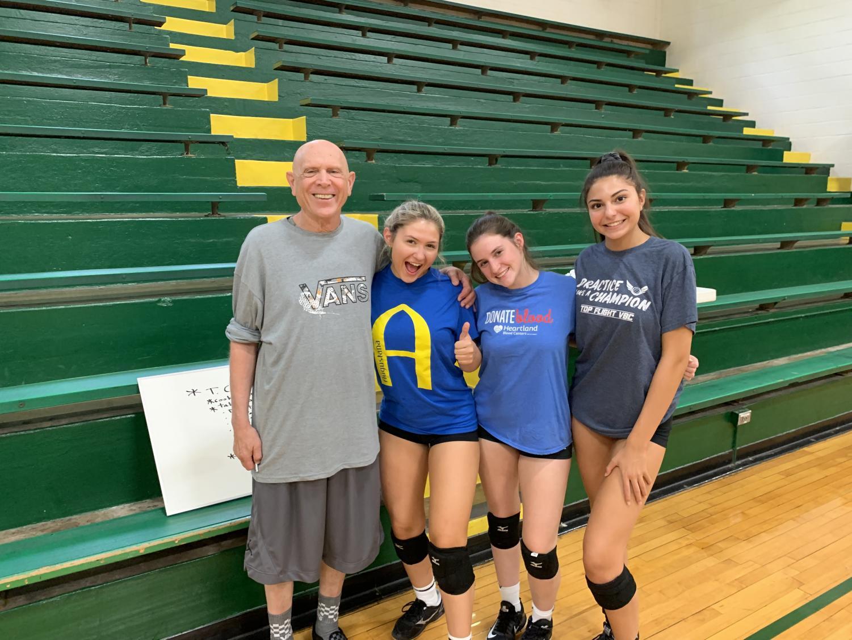 Girls varsity volleyball head coach Richard Pantich with seniors Natalie Stras, Amanda Saunders and Bianca Ventimiglia.