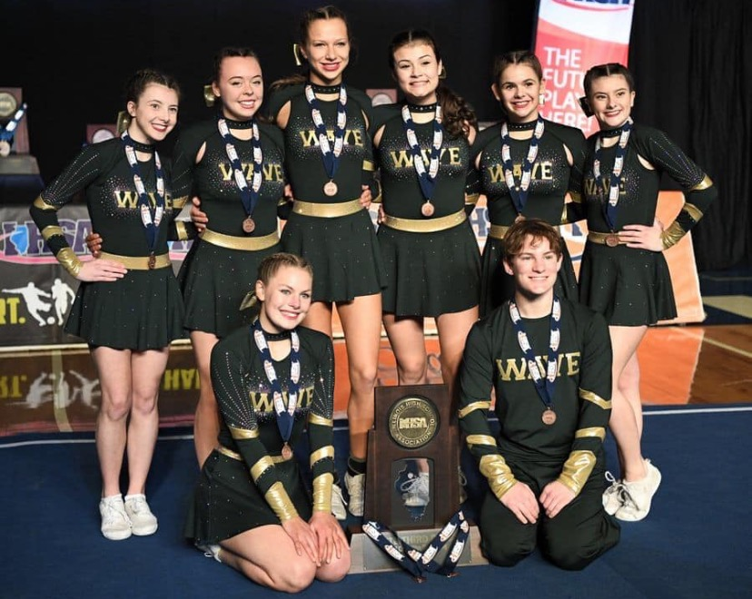 Gabriella Sarullo, Grace Vitek, Alexa Cirrincione, Isabella Kirkwood, Ashley Mahute, Emily Sarullo, Lola Jarzemsky, and Alex Walser pose with their state trophy.