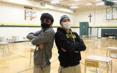 Members of the St. Edward Swim Team Nathan Mesina and Bobby Bansil are ready to see a new pool installed.