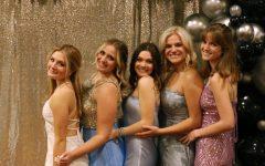 Mia Castro, Sarah Kirchen, Jase Leonard, Lainy Lundvick, and Maddie Wood pose at Prom.