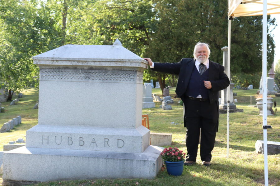 William Hubbard actor leans against his grave